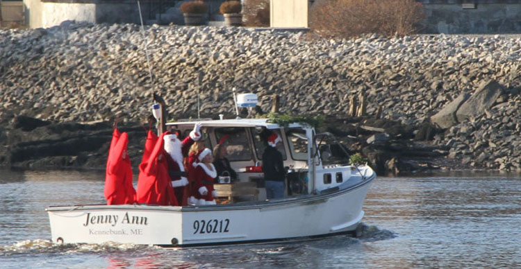 Santa arrives on a Lobster Boat